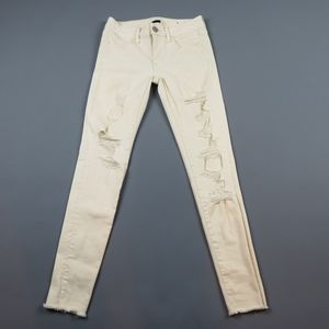 AMERICAN EAGLE Cream Ripped Raw hem Jeggings